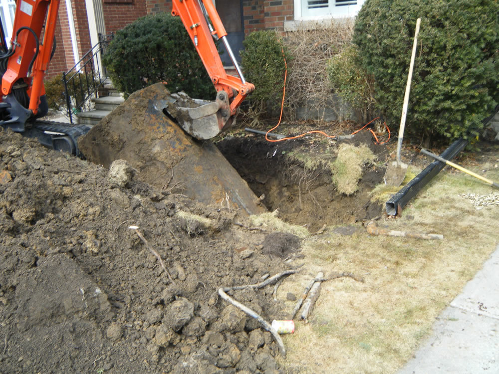 Waterline Environmental removing the residential oil tank with a backhoe