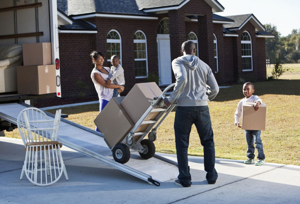 Family packing a moving truck